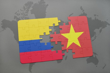puzzle with the national flag of colombia and vietnam on a world map background. 3D illustration