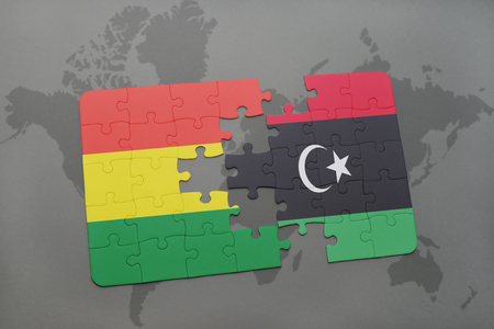 puzzle with the national flag of bolivia and libya on a world map background. 3D illustration