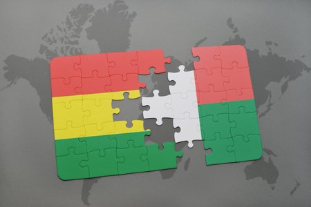 puzzle with the national flag of bolivia and madagascar on a world map background. 3D illustration Banco de Imagens