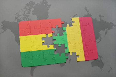puzzle with the national flag of bolivia and mali on a world map background. 3D illustration