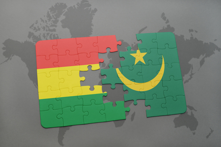 puzzle with the national flag of bolivia and mauritania on a world map background. 3D illustration Banco de Imagens