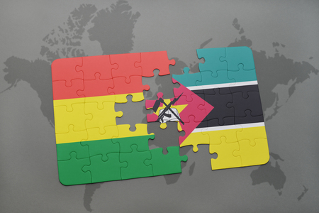 puzzle with the national flag of bolivia and mozambique on a world map background. 3D illustration Banco de Imagens