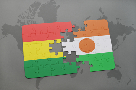 puzzle with the national flag of bolivia and niger on a world map background. 3D illustration