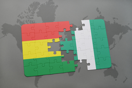 puzzle with the national flag of bolivia and nigeria on a world map background. 3D illustration
