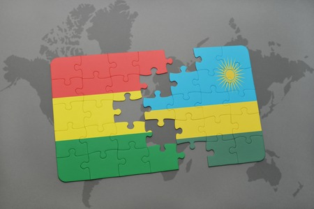 puzzle with the national flag of bolivia and rwanda on a world map background. 3D illustration