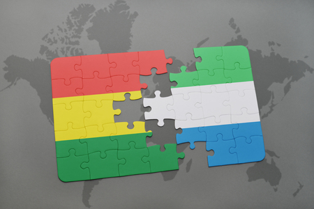 puzzle with the national flag of bolivia and sierra leone on a world map background. 3D illustration
