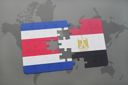 puzzle with the national flag of costa rica and egypt on a world map background. 3D illustration Stock Photo