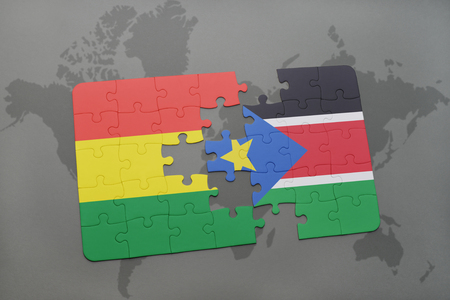 puzzle with the national flag of bolivia and south sudan on a world map background. 3D illustration
