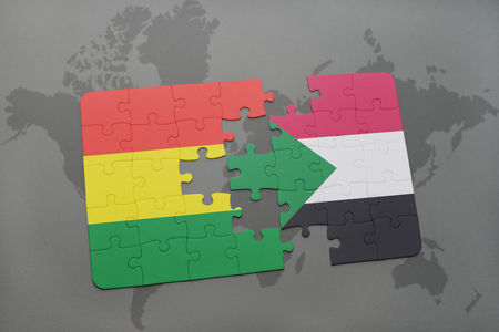 puzzle with the national flag of bolivia and sudan on a world map background. 3D illustration Banco de Imagens