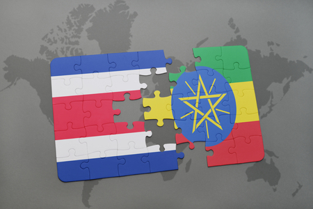 puzzle with the national flag of costa rica and ethiopia on a world map background. 3D illustration