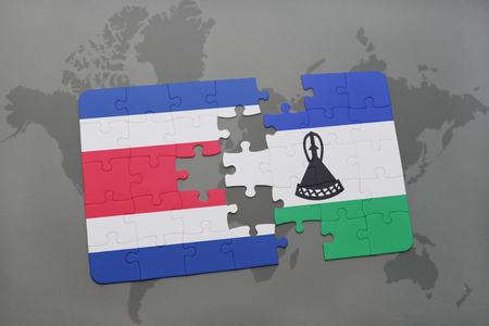 puzzle with the national flag of costa rica and lesotho on a world map background. 3D illustration