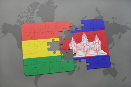 cambodian: puzzle with the national flag of bolivia and cambodia on a world map background. 3D illustration