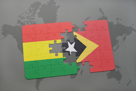 puzzle with the national flag of bolivia and east timor on a world map background. 3D illustration