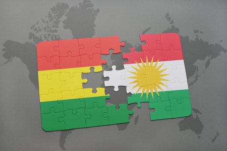 puzzle with the national flag of bolivia and kurdistan on a world map background. 3D illustration