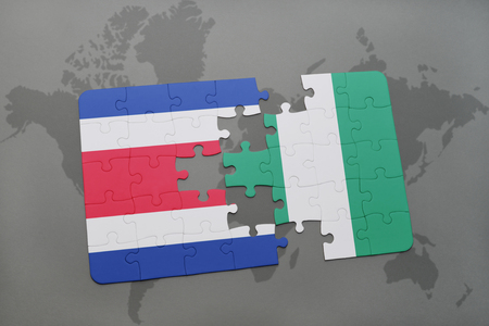 puzzle with the national flag of costa rica and nigeria on a world map background. 3D illustration