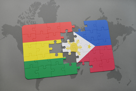puzzle with the national flag of bolivia and philippines on a world map background. 3D illustration Banco de Imagens