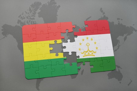 puzzle with the national flag of bolivia and tajikistan on a world map background. 3D illustration