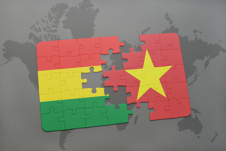 puzzle with the national flag of bolivia and vietnam on a world map background. 3D illustration