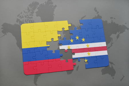 puzzle with the national flag of colombia and cape verde on a world map background. 3D illustration
