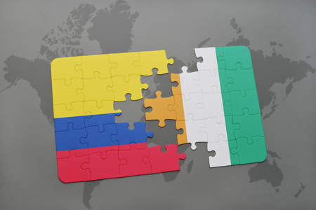 puzzle with the national flag of colombia and cote divoire on a world map background. 3D illustration Stock Photo