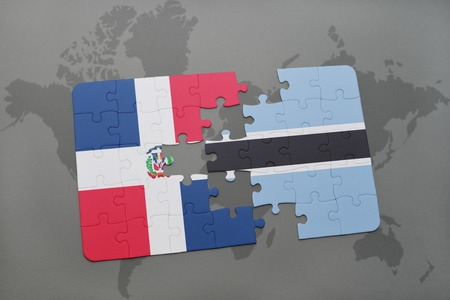 puzzle with the national flag of dominican republic and on a world map background. 3D illustration