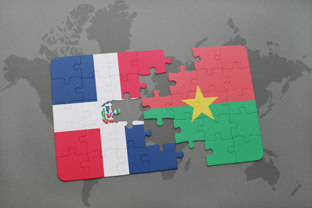 puzzle with the national flag of dominican republic and burkina faso on a world map background. 3D illustration