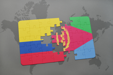 puzzle with the national flag of colombia and eritrea on a world map background. 3D illustration Stock Photo