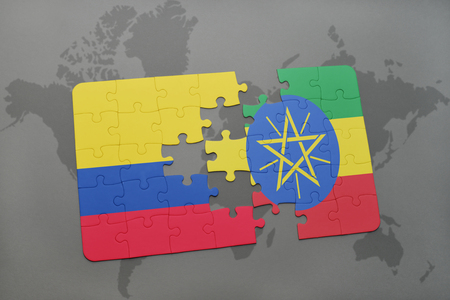 puzzle with the national flag of colombia and ethiopia on a world map background. 3D illustration
