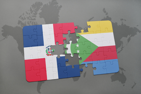 puzzle with the national flag of dominican republic and comoros on a world map background. 3D illustration