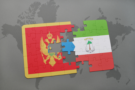 puzzle with the national flag of montenegro and equatorial guinea on a world map background. 3D illustration Stock Photo