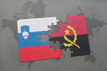 puzzle with the national flag of slovenia and angola on a world map background. 3D illustration Stok Fotoğraf