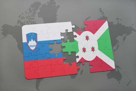 puzzle with the national flag of slovenia and burundi on a world map background. 3D illustration