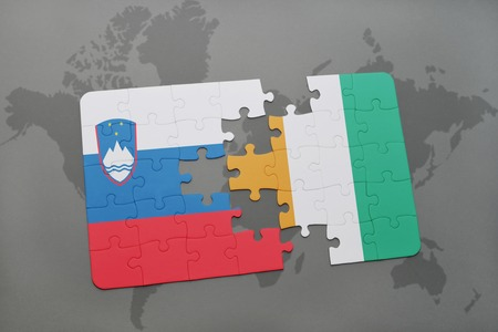 slovenian: puzzle with the national flag of slovenia and cote divoire on a world map background. 3D illustration