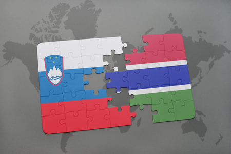 puzzle with the national flag of slovenia and gambia on a world map background. 3D illustration