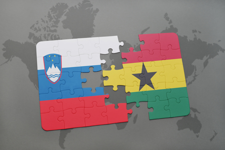 slovenian: puzzle with the national flag of slovenia and ghana on a world map background. 3D illustration