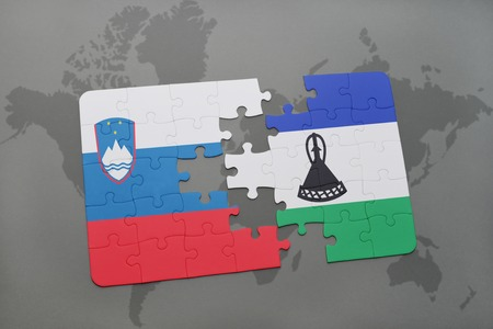 slovenian: puzzle with the national flag of slovenia and lesotho on a world map background. 3D illustration