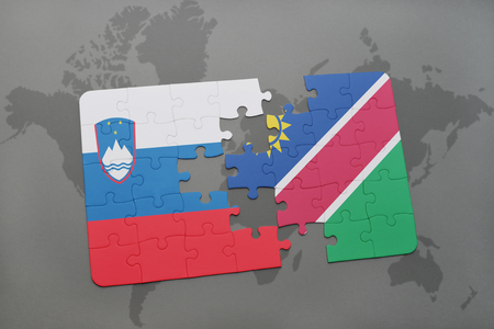 puzzle with the national flag of slovenia and namibia on a world map background. 3D illustration