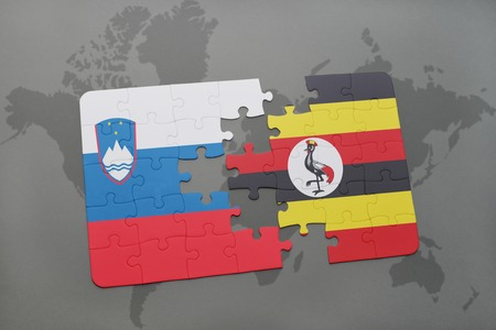 kampala: puzzle with the national flag of slovenia and uganda on a world map background. 3D illustration Stock Photo