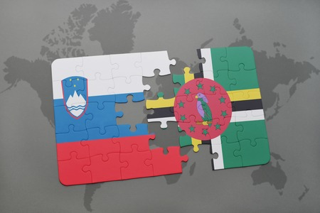 slovenian: puzzle with the national flag of slovenia and dominica on a world map background. 3D illustration Stock Photo