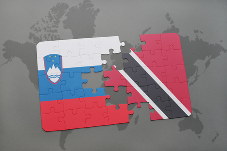 puzzle with the national flag of slovenia and trinidad and tobago on a world map background. 3D illustration