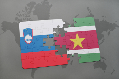 slovenian: puzzle with the national flag of slovenia and suriname on a world map background. 3D illustration Stock Photo