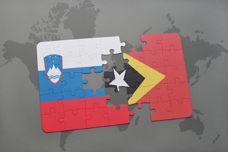 puzzle with the national flag of slovenia and east timor on a world map background. 3D illustration Stock Photo