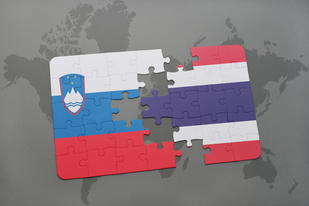 puzzle with the national flag of slovenia and thailand on a world map background. 3D illustration