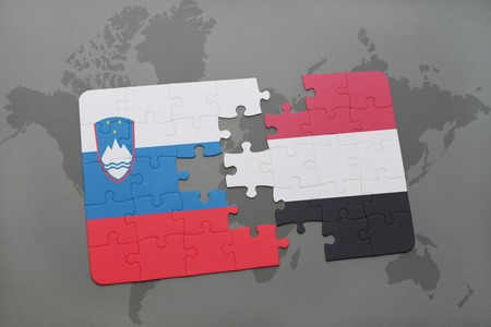 slovenian: puzzle with the national flag of slovenia and yemen on a world map background. 3D illustration