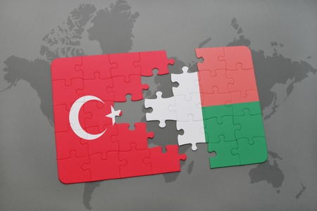 puzzle with the national flag of turkey and madagascar on a world map background. 3D illustration