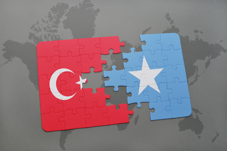 puzzle with the national flag of turkey and somalia on a world map background. 3D illustration