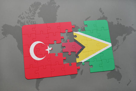 guyanese: puzzle with the national flag of turkey and guyana on a world map background. 3D illustration