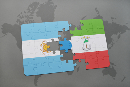puzzle with the national flag of argentina and equatorial guinea on a world map background. 3D illustration Stock Photo