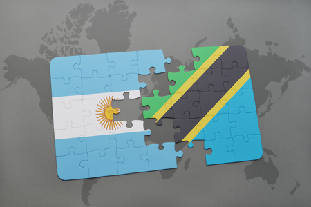 puzzle with the national flag of argentina and tanzania on a world map background. 3D illustration