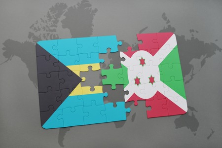 puzzle with the national flag of bahamas and burundi on a world map background. 3D illustration